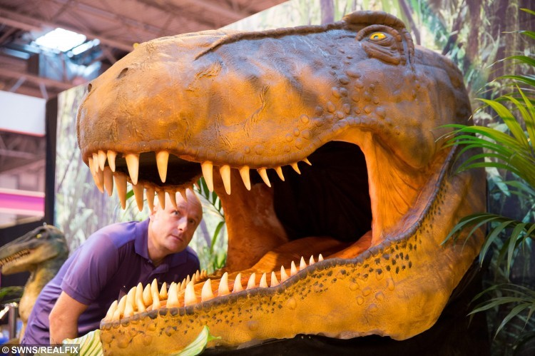A Jurassic Cake display featuring a full size head of a Tyrannosaurus Rex on display at the Cake International show at the NEC, Birmingham. November 6 2015. See NTI story NTICAKE.