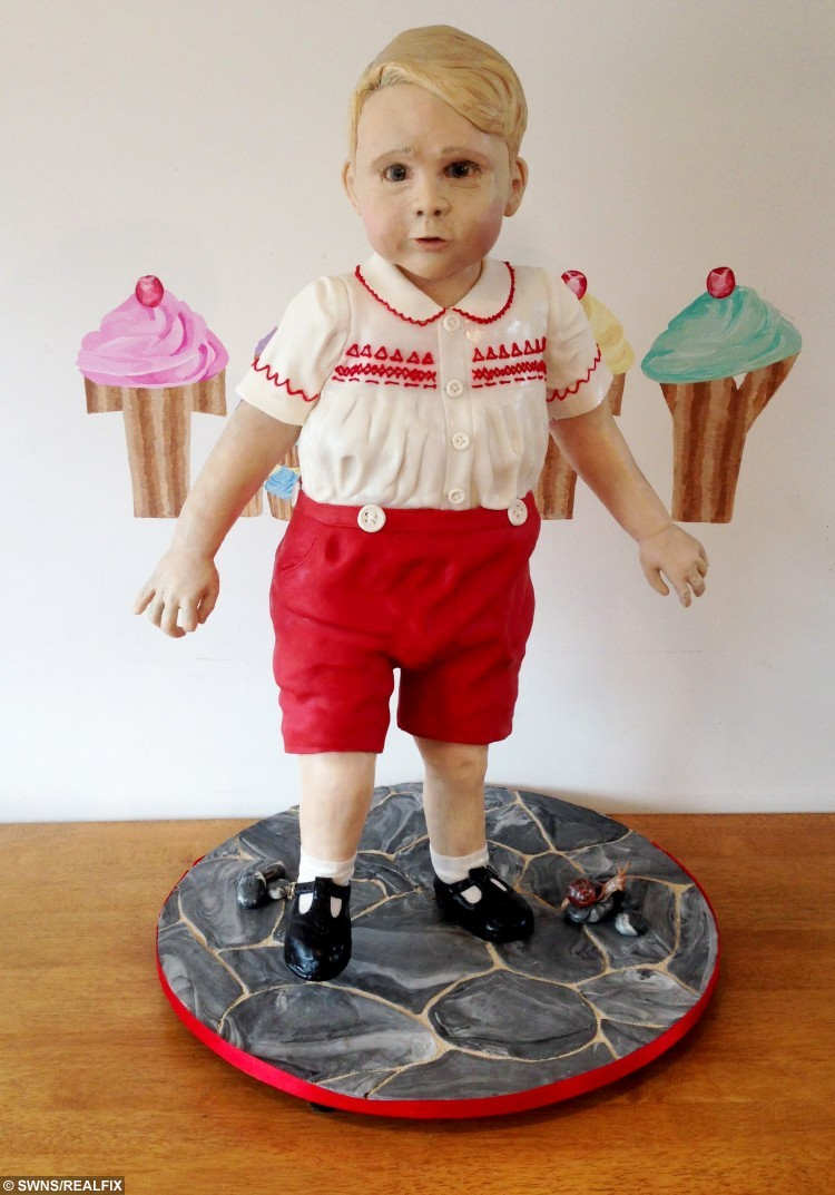 Collect photo that shows the creation of the baby George cake display at the Cake International show at the NEC, Birmingham. November 6 2015.  See NTI story NTICAKE.