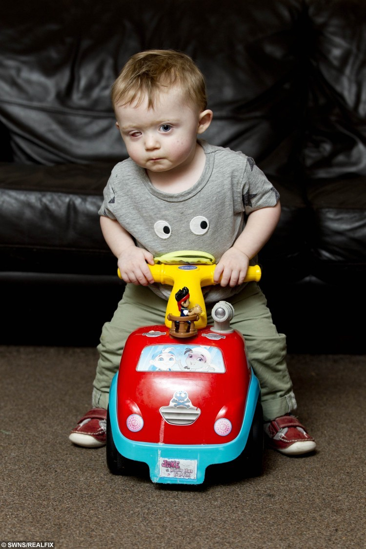 18 month year old Oscar Webb has lost an eye after being hit by a drone, Stourport on Severn, November 28 2015. See NTI story NTIDRONE; A devastated couple have issued an urgent warning to parents after their 18-month-old son was struck in the face by an out-of-control drone and lost an EYE. Little Oscar Webb was playing in a neighbour's garden while his dad watched family friend Simon Evans, 29, fly his Ã300 'quadcopter' device with a remote control. But it clipped a tree as he was trying to land it and spiralled out of control, hitting the toddler in the face. Dad Rick Webb, 30, could only watch as the propellers sliced through Oscar's right eye, causing him to scream out in pain. Desperate Rick phoned for an ambulance and paramedics dashed to the house in Stourport-on-Severn, Worcs., at around 1pm on October 10.