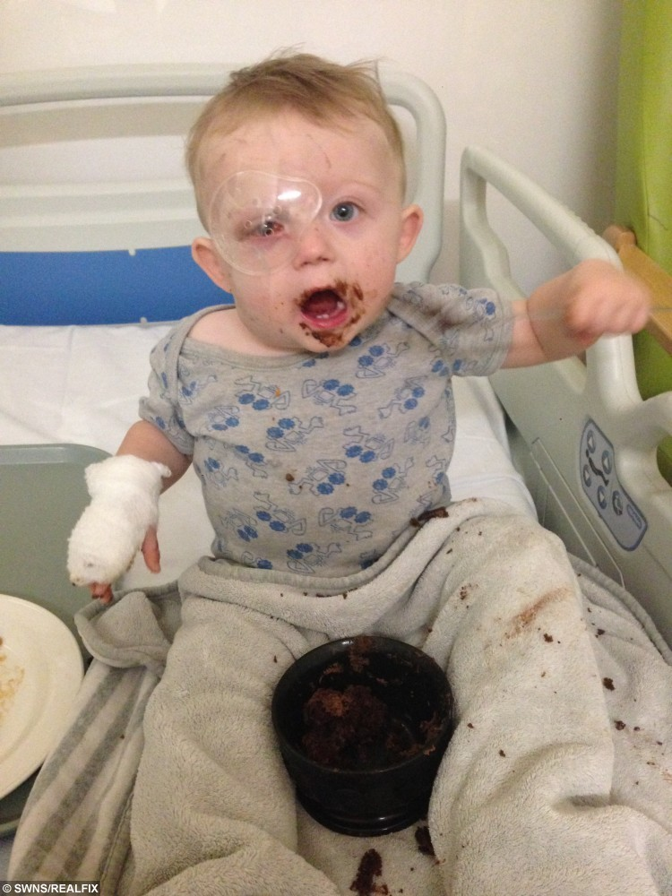 Collect of18 month year old Oscar Webb in hospitail. He has lost an eye after being hit by a drone, Stourport on Severn, November 28 2015. See NTI story NTIDRONE; A devastated couple have issued an urgent warning to parents after their 18-month-old son was struck in the face by an out-of-control drone and lost an EYE. Little Oscar Webb was playing in a neighbour's garden while his dad watched family friend Simon Evans, 29, fly his Ã300 'quadcopter' device with a remote control. But it clipped a tree as he was trying to land it and spiralled out of control, hitting the toddler in the face. Dad Rick Webb, 30, could only watch as the propellers sliced through Oscar's right eye, causing him to scream out in pain. Desperate Rick phoned for an ambulance and paramedics dashed to the house in Stourport-on-Severn, Worcs., at around 1pm on October 10.