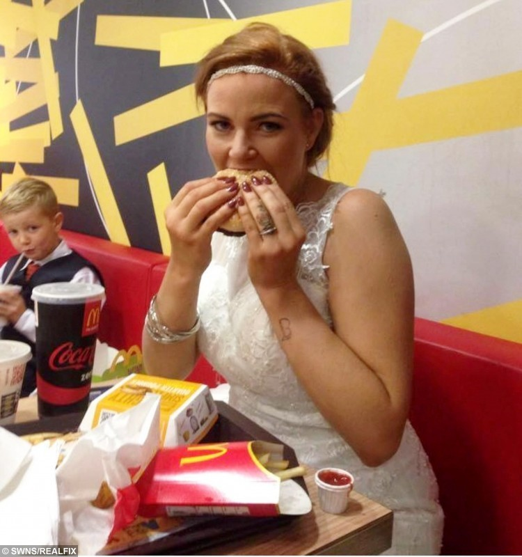 Collect picture of bride Antoinette Sullivan on her wedding day in Mcdonalds.  A bride munches on a McDonald's burger in her dress after her new husband left her to go paintballing for his stag do - on their WEDDING DAY.  See NTI story NTIBRIDE.  Antoinette, 28, and Miles Sullivan, 23, tied the knot in a secretive ceremony in front of just 15 guests at midday last Friday (30/10).  But just minutes after they said their vows Miles left his new wife to go paintballing with his pals - who hadn't been able to throw him a stag do.  Antoinette and her girlfriends then went to a nearby pub before the bride, who was still wearing her white backless wedding dress, strolled into a busy city centre McDonald's.  Despite the stunned looks, she polished off a quarter pounder burger with chips and mozzarella sticks - before even managing to spill her coke over the bottom of her dress.  The newlyweds then met up again on the evening and surprised the 40 guests at their wedding do - because they had only told them it was an engagement party.