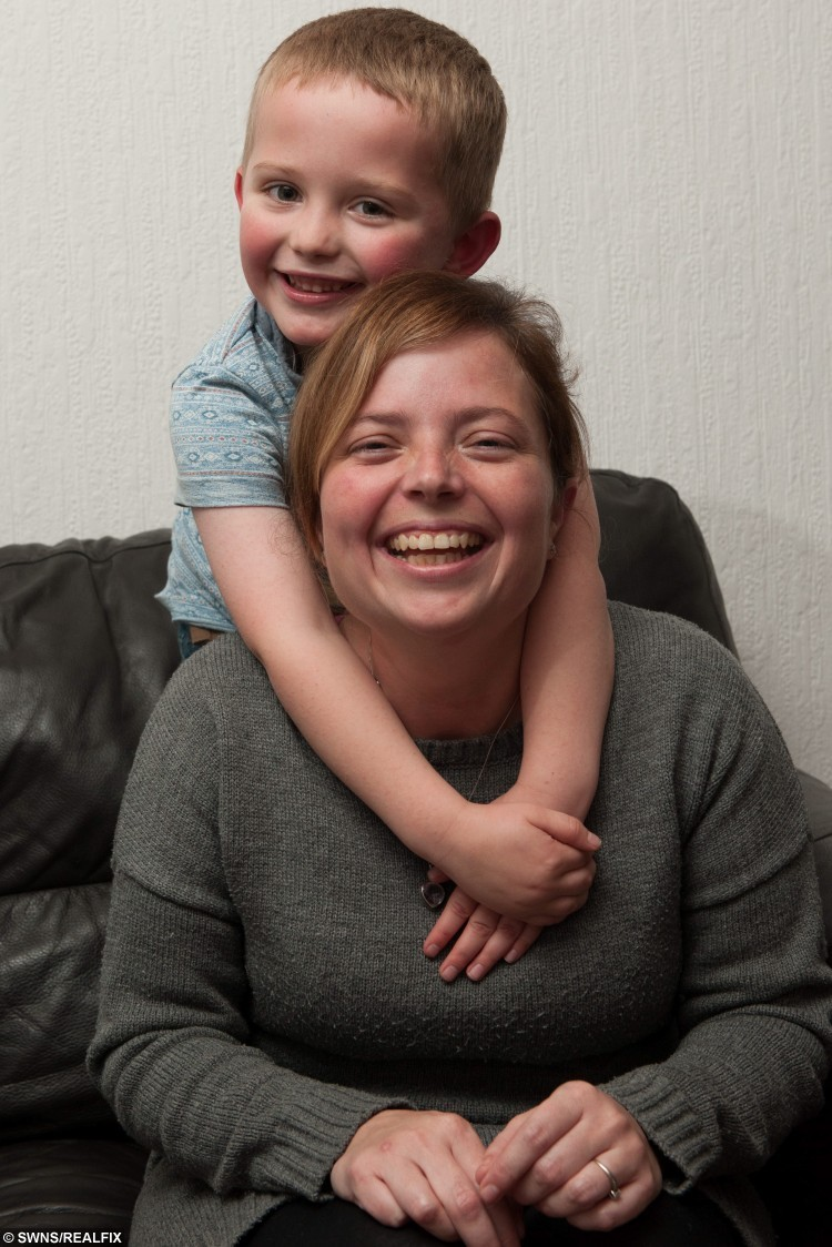 Michelle Humber (33), pictured with son Ronnie (5).  See NTI story NTCAT.  This is the heart-melting moment a five-year-old boy bursts into tears of joy when he spots his long-lost cat in a rescue centre - 18 months after it went missing. Michelle Humber and her son Ronnie had gone to pick out a replacement pet when they stumbled across their old cat Phoenix who vanished from their home in May last year.  In an incredible coincidence, ten-year-old Phoenix was in an enclosure next to a cat called Orlando who they had arranged to collect from their local Cats Protection charity.  The family now plan to give both cats a home when they pick them up this weekend.