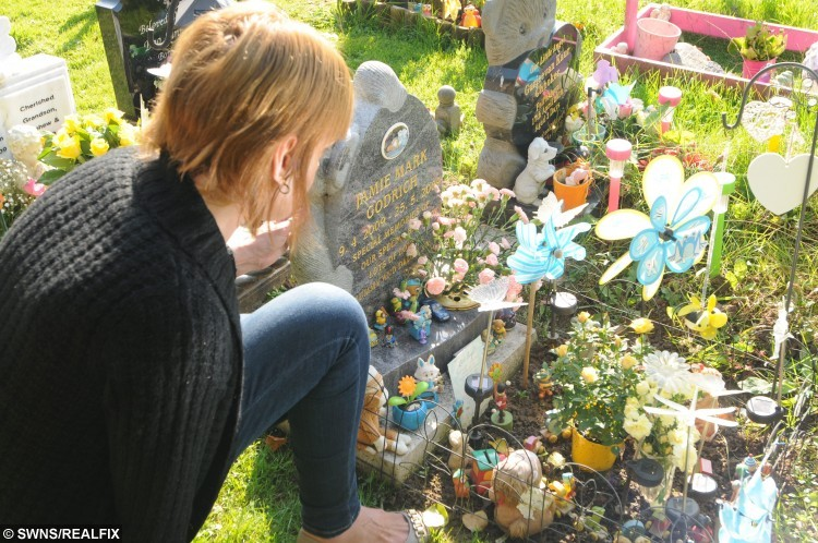 Tracey Bolton at the grave of her son  of Jamie Mark Godrich at The Baby Garden at Nottingham Road Cemetery in Nottingham. See NTI story NTIGRAVE; A desperate mum may have her baby boy's body EXHUMED because thieves keep stealing toys from his grave. Heartbroken Tracey Bolton, 43, has been leaving teddy bears and toys at tragic Jamie Godrich's grave, who died in 2009 when he was just six weeks old. Cruel thieves have targeted the grave three times in the past month, stealing Lego and action figures from Nottingham Road Cemetery in Chaddesden, Derbys. The heartless yobs have caused further misery by throwing toys across the cemetery and Tracey feels she is being deliberately targeted.