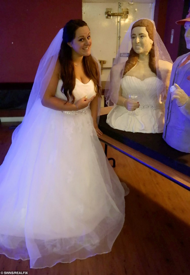 A baking-mad bride stunned guests when she unveiled two wedding cakes - in the shape of herself and her groom.  See NTI story NTICAKE.  Lara Mason, 29, spent three days baking and icing the life-size cakes in time for her wedding to Nikki (corr) Mason, 27.  The couple tied the knot in Malta on October 17 but unveiled the giant cakes as they held a family party in Great Wyrley, Staffs., on Saturday (14/11).  The delicious doubles, which are entirely edible, were made from 20kg (44lb) of icing and 20kg of chocolate cake.  Lara's cake doppelganger shows her wearing a white wedding dress, complete with veil and holding a cocktail glass.  But the talented baker gave her new husband a 'marriage survival kit' hat with two cans of beer and straws leading to his mouth.   Yesterday (Thur), Lara, who works in customer services for Tombola Bingo, said she managed to make the life-size cakes in just three days.