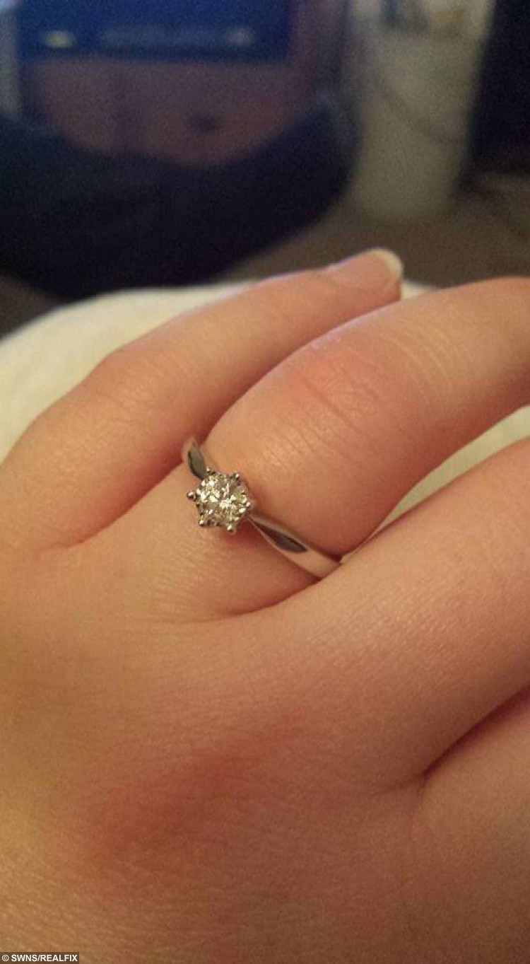 """Rebecca May Cressey's engagement ring. See Ross Parry copy RPYAQUA : A man took the plunge and proposed to his girlfriend while they were swimming with sharks. Rebecca May Cressey thought they were just going diving for her birthday, but Steven Purdiew had enlisted Skegness Aquarium staff to help him propose. Miss Cressey saw a board asking """"Will you marry me?"""" then put her thumbs up to say she would. The couple, from Somercotes in Derbyshire, now plan to get married in a year or two."""