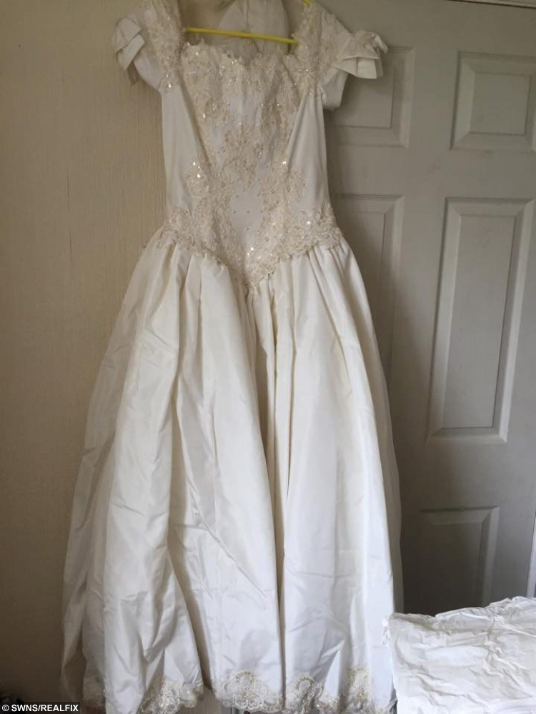 """Amanda Ibbotson and Mandy Shippey from Bridlington, North Yorkshire, who turn donated wedding dresses into baby gowns for stillborn babies. Pictured is one of the donated wedding dresses. See Ross Parry copy RPYGOWNS : A woman is offering grieving parents a unique way to say goodbye to their beloved babies - by transforming beautiful wedding dresses into burial outfits. Mandy Shippey, 40, has set up not-for-profit organisation Too Beautiful for Earth with her friend Amanda Ibbotson, 37. Mandy has been inundated with donations so far - receiving 30 wedding dresses and material and buttons to make waistcoats for little boys. Mandy, who first saw the project in America, said: """"I properly started the project about a month ago and have had such as amazing response. """"We have had 30 wedding dresses donated so far and a lot of local businesses have helped us with material, buttons and blue cotton for waistcoats for little boys."""