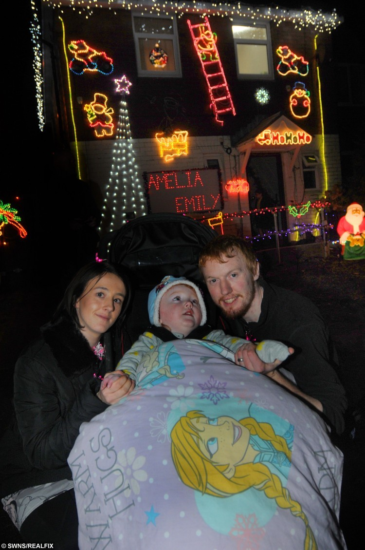 Young Amelia Morris celebrates her 3rd birthday at her home in Wigan with parents Whitney and Jonny Morris. See Ross Parry copy RPYGROTTO:This was the magical moment a terminally ill tot's dream came true as her home was transformed into a sparkling grotto. Poorly Amelia Morris, three, was in awe as thousands of bright festive lights were switched on and she was presented with a mound of presents. The tot suffers from Tay-Sachs disease, a rare genetic disorder that attacks the nervous system, and causes the deterioration of mental and physical abilities. Her parents, Whitney and Jonny Morris, were dealt the devastating blow that this could be her last Christmas and decided to do everything they could to make it magical for Amelia.