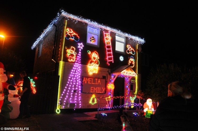 The home in Wigan that was transformed into a grotto for Young Amelia Morris' 3rd birthday. See Ross Parry copy RPYGROTTO:This was the magical moment a terminally ill tot's dream came true as her home was transformed into a sparkling grotto. Poorly Amelia Morris, three, was in awe as thousands of bright festive lights were switched on and she was presented with a mound of presents. The tot suffers from Tay-Sachs disease, a rare genetic disorder that attacks the nervous system, and causes the deterioration of mental and physical abilities. Her parents, Whitney and Jonny Morris, were dealt the devastating blow that this could be her last Christmas and decided to do everything they could to make it magical for Amelia.