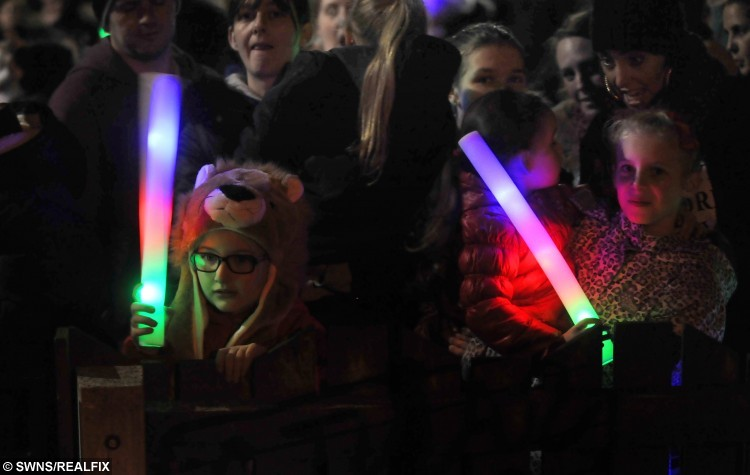 Neighbours, friends, family and well-wishers gathered in the street to see the Christmas light switch-on to celebrate the third birthday of Amelia Morris, from Beech Hill, Wigan, and possibly her last Christmas, after an appeal for lights and gifts. See Ross Parry copy RPYGROTTO:This was the magical moment a terminally ill tot's dream came true as her home was transformed into a sparkling grotto. Poorly Amelia Morris, three, was in awe as thousands of bright festive lights were switched on and she was presented with a mound of presents. The tot suffers from Tay-Sachs disease, a rare genetic disorder that attacks the nervous system, and causes the deterioration of mental and physical abilities. Her parents, Whitney and Jonny Morris, were dealt the devastating blow that this could be her last Christmas and decided to do everything they could to make it magical for Amelia.