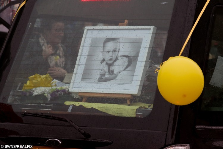 Hundreds of people lined York Road in Hartlepool today to release a yellow balloon as the hearse passed afte rthe funeral of Jacob Jenkins, two, who died after choking on a grape at Pizza Hut. His funeral took place today at St Josephs RC Church in Hartlepool. October 28 2015. See RPYGRAPE
