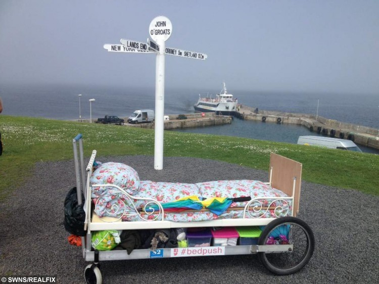 Rosie at the end of her journey in Land's End. Rosie Mai pushed a bed on wheels all the way from John OÃGroats to LandÃs End to raise money for charity. See Centre Press story CPBED; A Scottish charity fundraiser has completed a five month challenge - pushing her bed the length of the UK. Rosie Mai Iredale, 26, reached her final destination of Land's End on Monday afternoon, having set off from John O'Groats in her pyjamas in May. She travelled on minor roads and walked trails for 1,200 miles, experiencing all types of weathers and sleeping in car parks, lay-bys and conservatories. Her efforts have seen her raise Ã21,000 which will go towards opening a children's home in Bristol. Rosie, originally from Edinburgh, even adopted a stray kitten which she picked up en route.