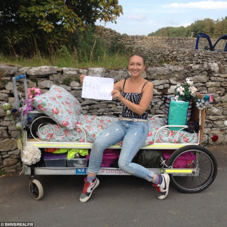 Rosie Mai pushed a bed on wheels all the way from John OÃGroats to LandÃs End to raise money for charity. See Centre Press story CPBED; A Scottish charity fundraiser has completed a five month challenge - pushing her bed the length of the UK. Rosie Mai Iredale, 26, reached her final destination of Land's End on Monday afternoon, having set off from John O'Groats in her pyjamas in May. She travelled on minor roads and walked trails for 1,200 miles, experiencing all types of weathers and sleeping in car parks, lay-bys and conservatories. Her efforts have seen her raise Ã21,000 which will go towards opening a children's home in Bristol. Rosie, originally from Edinburgh, even adopted a stray kitten which she picked up en route.