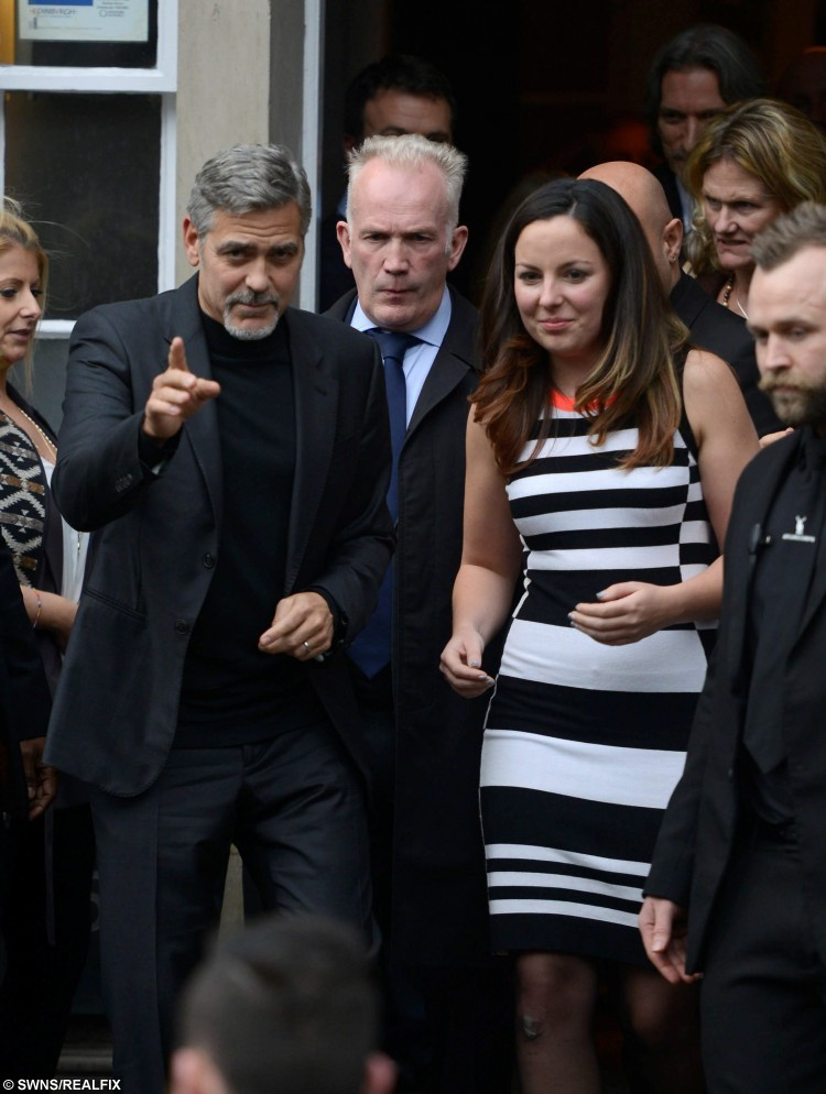 Hollywood actor George Clooney leaves TigerLily in Edinburgh, Scotland, with competition winner Heather McGowan, who had lunch with him, November 12, 2015.  See Centre Press story CPCLOONEY; The Hollywood star George Clooney jetted into Scotland to visit a not-for-profit sandwich shop, Social Bite, before speaking at the prestigious Scottish Business Awards. The A-lister will spent the day in Edinburgh and met staff of Social Bite who were once homeless but now work in the chain of cafes which donates its profits to charity.