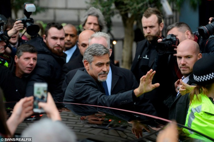 Hollywood actor George Clooney leaves TigerLily in Edinburgh, Scotland, where he met a competition winner who lunch with him, November 12, 2015.  See Centre Press story CPCLOONEY; The Hollywood star George Clooney jetted into Scotland to visit a not-for-profit sandwich shop, Social Bite, before speaking at the prestigious Scottish Business Awards. The A-lister will spent the day in Edinburgh and met staff of Social Bite who were once homeless but now work in the chain of cafes which donates its profits to charity.