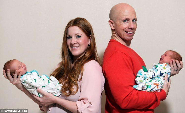 Alanna and Paul Merrie with newborn twins Kaius and Troy.  Alanna holding Kaius and Paul with Troy.  A proud couple have given birth to a set of twins -- believed to be the heaviest ever born in Scotland.  See CENTRE PRESS story CPTWINS.  Alanna Merrie, 33, and her husband Paul knew they were expecting twins but not that they would have a pair of record breakers.  Their boys, Troy and Kaius, are now thought to be the heaviest twins born in Scotland after tipping the scales at a combined total of 16lb 13oz.  The brothers were born by caesarean section and astonished midwives with their size at Edinburgh Royal Infirmary on November 4.  They weighed 8lb 12oz and 8lb 1oz respectively.  Alanna and Paul, from the Newington area of Edinburgh, were able to take their sons home on Thursday night after spending a week in hospital.