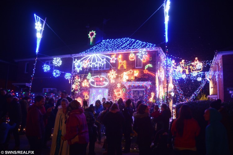 Stuart Bizley's Christmas lights switch on in Ruthven Road, Knowle to raise money for Alzheimer's Society. See SWNS story SWLIGHTS; It might still be November but this house has already gone Christmas crazy - after being covered in 4,000 fairy lights. Stuart Bizley, 22, loves the festive season and spends the entire year buying new light fittings, sparkling reindeer and illuminated Santas. The care assistant - who strings up 1,700 lights on the roof alone - reckons the illuminations cost Ã10,000 to buy, with the electricity bill coming to Ã10 a day. He is so proud of the display, which takes two months to set up, he hosted an official lights switch-on ceremony for his neighbours in Knowle, Bristol, on Saturday.