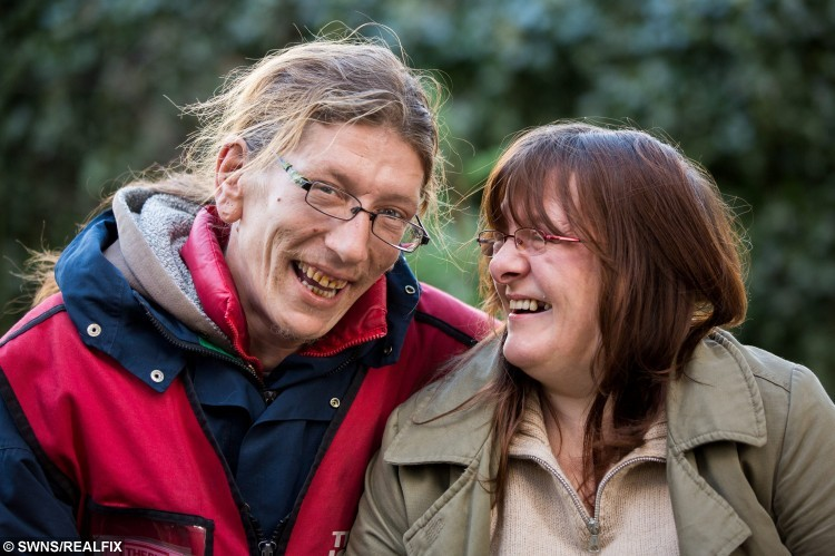 Big Issue seller Jack Richardson with Toni Robinson at home in Bristol. They fell in love after Jack asked her for money whilst working. 22 November 2015.   See SWNS story SWTRAMP; One of Bristol's best known Big Issue sellers is getting married to a woman he first met when he asked her for money while begging. But when Jack Richardson asked Toni Robinson for money almost two years ago, she apologised saying that she had none. Jack ended up giving Toni 50p so she could feed her electricity meter enabling her not to have to spend Christmas 2013 in the dark. Over the next year, Toni often used to pass Jack's Big Issue pitch outside Boston Tea Party on Park Street and they became firm friends. When JackÃs squat in a garage near the Victoria Rooms in Clifton got boarded up and he had nowhere else to go, Toni offered to put him up for a couple of months.