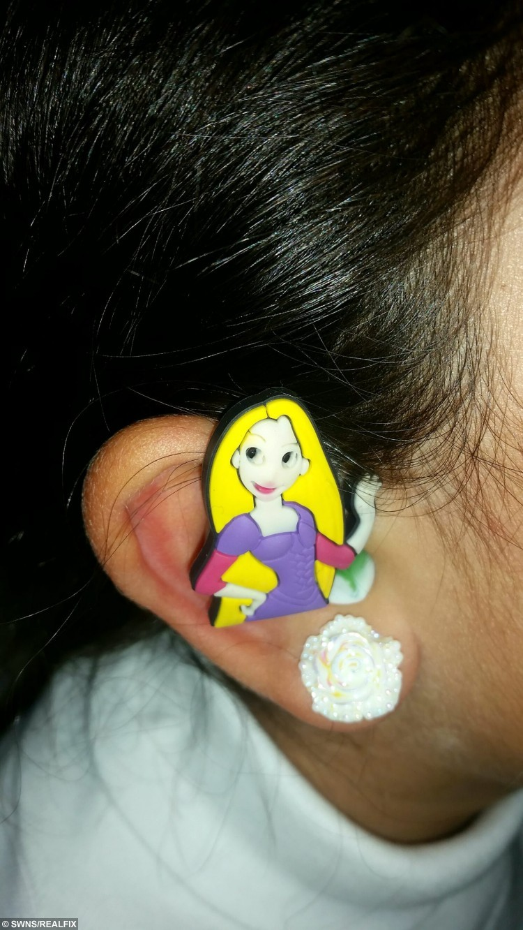 """Collect of the Rapunzel cartoon hearing aid cover. See SWNS story SWHEAR; A mum has helped her deaf son beat the bullies by putting colourful cartoon covers - on his HEARING AIDS. Little Santiago Lozada was diagnosed with deafness earlier this year after having trouble concentrating at school and ordered to wear two hearing aids. Nathalie Lozada, 32, was horrified when she realised her five-year-old son was being teased at school because of his new hearing aids, which he hated wearing, so she decided to stick his favourite cartoon characters on the sides. Nathalie, a deputy nursery nurse, said: """"He was given hearing aids but associates them with his school uniform so doesn't like to wear them."""""""