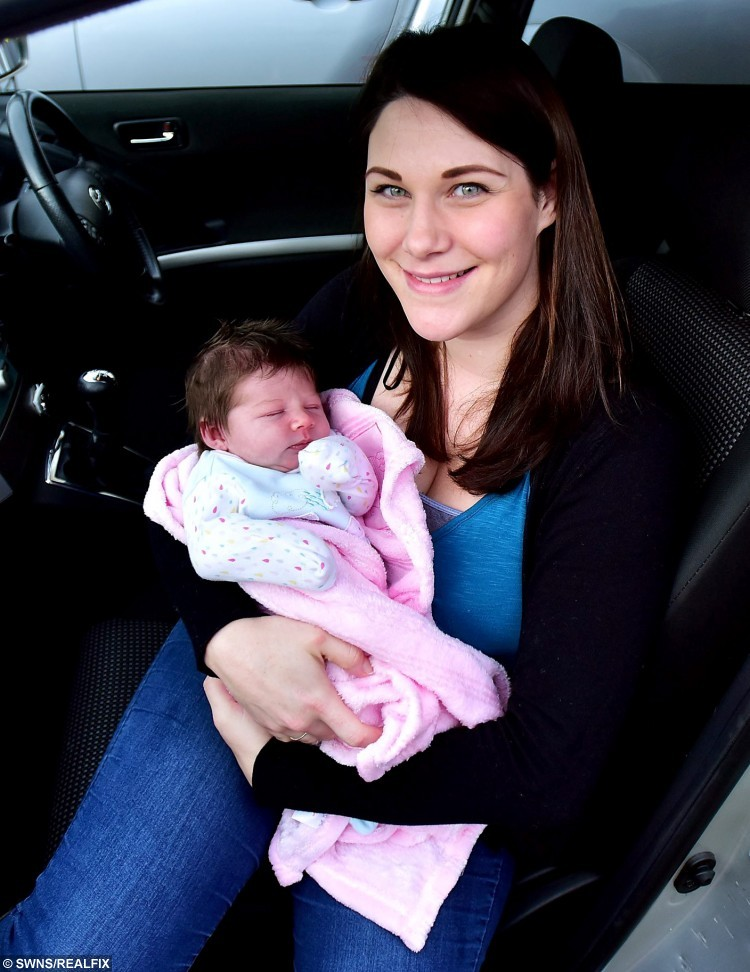 Kate Wilshere with her daughter Hetty - who was born in her car. See SWNS story SWBABY: A woman born at the side of the road has kept up the family tradition - after giving birth herself on the way to hospital. Kate Wilshire arrived in a hurry in 1986 when her mum Sharon pulled over as she drove to a maternity unit in Bristol. Almost 30 years later, she has now done the same thing with daughter Hetty being born as husband Aaron rushed her to hospital. The couple rang midwives when the baby began to emerge and were guided through the birth as they drove with their phone on hands-free mode.