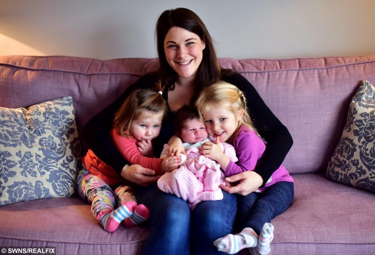 Kate Wilshere with her daughter Hetty - who was born in her car. Also pictured are her daughters Heidi (left), 20 months and Bonnie, 3. See SWNS story SWBABY: A woman born at the side of the road has kept up the family tradition - after giving birth herself on the way to hospital. Kate Wilshire arrived in a hurry in 1986 when her mum Sharon pulled over as she drove to a maternity unit in Bristol. Almost 30 years later, she has now done the same thing with daughter Hetty being born as husband Aaron rushed her to hospital. The couple rang midwives when the baby began to emerge and were guided through the birth as they drove with their phone on hands-free mode.