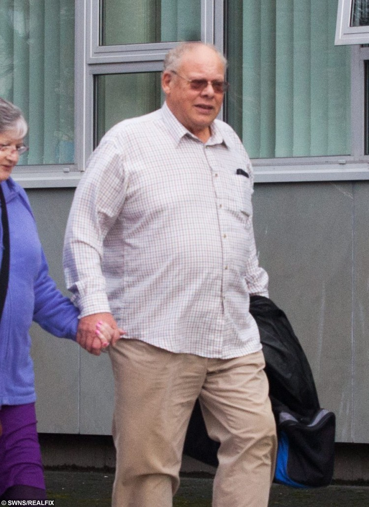 "Andrew Fulcher arrives at the Plymouth Crown Court in Devon with an unidentified woman. See SWNS story SWVICTIM; A woman who was sexually abused by her stepfather has spoken out after watching him jailed - thirty years after he attacked her. Brave Leyna Tucker, 46, faced her abuser Andrew Fulcher, 64, in court - and afterwards waived her right to anonymity to encourage other victims of abuse to come forward. Fulcher had denied eight counts of indecent assault against Leyna and another girl between 1930 and 1987, but was convicted by a jury. Leyna smiled as she left the court, as Fulcher was branded ""evil and sadisctic"" by a judge who sentenced him to four years behind bars."