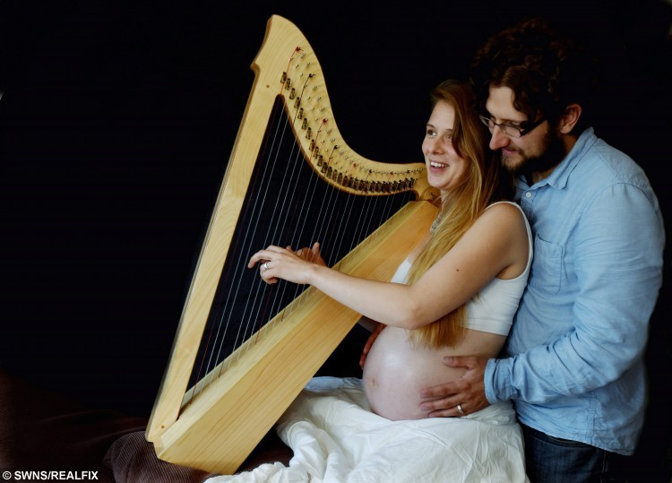 Morwenna Louttit-Vermaat plays a harp made by her husband Creag at their home in Gloucestershire. See SWNS story SWHARP; A baby was given perhaps the most serene entrance into the world when his mother played the harp - throughout labour. Musical Morwenna Rose Louttit-Vermaat [corr], 29, composed a song specially for baby Django earlier in her pregnancy and thought it would be a good distraction. Morwenna, who has played the harp for 17 years, plucked her 31-string Celtic instrument until the last phase of her son's four-hour home birth on 10 October. It proved so successful in soothing her that she didn't realise she was anywhere close to giving birth until midwives told her she was into the final stage of labour.