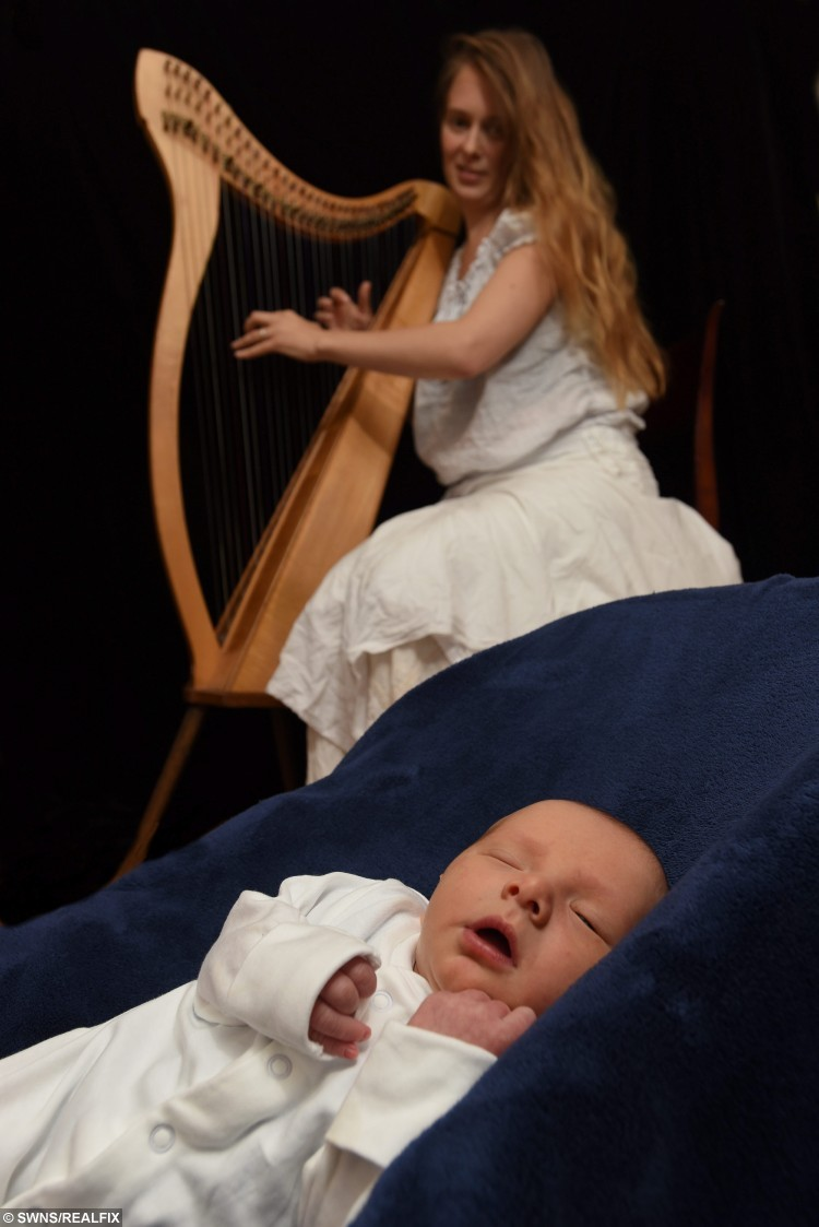 Morwenna Rose Louttit-Vermaat playing a harp made by her husband to their new born baby Django. See SWNS story SWHARP; A baby was given perhaps the most serene entrance into the world when his mother played the harp - throughout labour. Musical Morwenna Rose Louttit-Vermaat [corr], 29, composed a song specially for baby Django earlier in her pregnancy and thought it would be a good distraction. Morwenna, who has played the harp for 17 years, plucked her 31-string Celtic instrument until the last phase of her son's four-hour home birth on 10 October. It proved so successful in soothing her that she didn't realise she was anywhere close to giving birth until midwives told her she was into the final stage of labour.