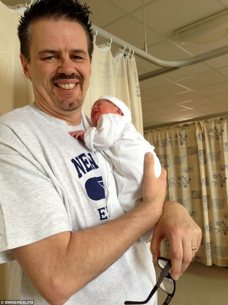 Collect photo of  Tony Greenhalgh with his then newborn daughter Adelaide. See SWNS story SWBABY; A mother has told of her joy at finally having her first child after a 10-year IVF struggle - costing a whopping Ã70,000. Teresa Greenhalgh, 46, and her husband Tony, 53, met in 2002 and almost immediately started trying for a baby in a bid to beat the ticking clock. The desperate pair ploughed Ã70,000 into seven rounds of IVF treatment over a decade, after failing to conceive naturally. The IT contractors, from Wrexham, north Wales, gave up holidays abroad and both worked 70-hour weeks to fund the expensive treatment.
