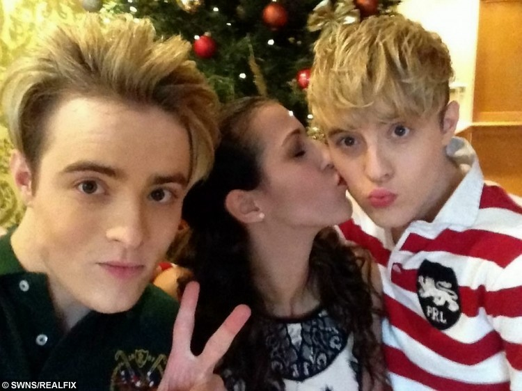 Catia Sousa at Tullamore court hotel, Ireland with Jedward for Christmas 2014. See SWNS story SWJEDWARD: A die-hard fan has spent a staggering Ã20,000 following JEDWARD around the world and has attended more than 400 of their concerts. Dedicated Catia Sousa, 20, became obsessed with quiffed identical twins John and Edward Grimes after they shot to fame on The X Factor in 2009 and has not looked back. This year alone she has been to more than 50 Jedward events including concerts and fan meet-ups and has spent all her earnings, savings and student loan on them. Single Catia even took two years out after school to dedicate her life to the boyband and postponed her degree at the University of London until this year.