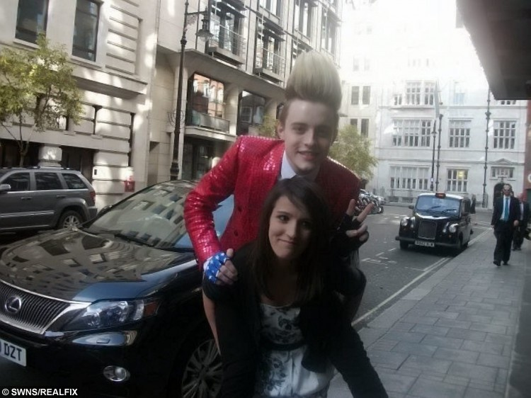 Catia Sousa with Jedward at the Mayfair Hotel in July 2011. See SWNS story SWJEDWARD: A die-hard fan has spent a staggering Ã20,000 following JEDWARD around the world and has attended more than 400 of their concerts. Dedicated Catia Sousa, 20, became obsessed with quiffed identical twins John and Edward Grimes after they shot to fame on The X Factor in 2009 and has not looked back. This year alone she has been to more than 50 Jedward events including concerts and fan meet-ups and has spent all her earnings, savings and student loan on them. Single Catia even took two years out after school to dedicate her life to the boyband and postponed her degree at the University of London until this year.