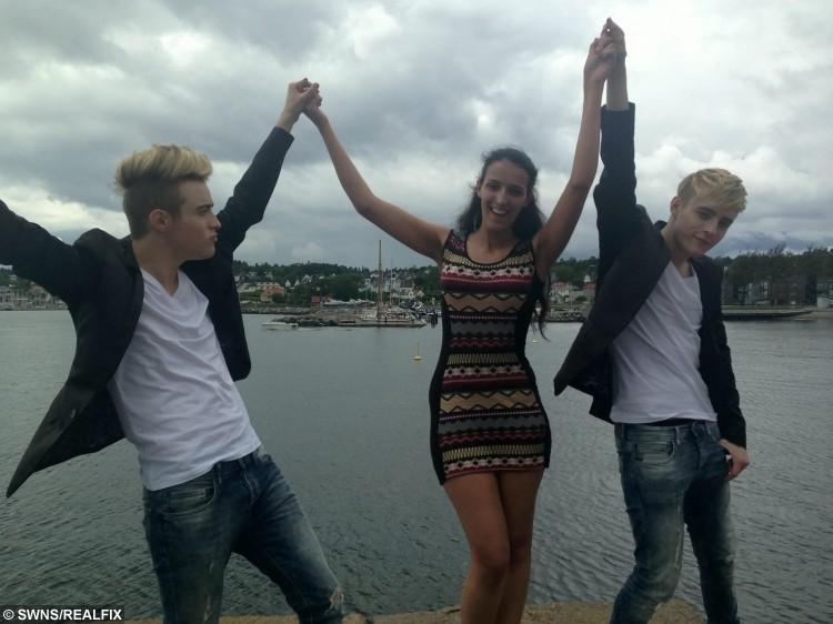 Catia Sousa holding hands with Jedward while they were in Oslo, Norway for their European tour in June 2015. See SWNS story SWJEDWARD: A die-hard fan has spent a staggering Ã20,000 following JEDWARD around the world and has attended more than 400 of their concerts. Dedicated Catia Sousa, 20, became obsessed with quiffed identical twins John and Edward Grimes after they shot to fame on The X Factor in 2009 and has not looked back. This year alone she has been to more than 50 Jedward events including concerts and fan meet-ups and has spent all her earnings, savings and student loan on them. Single Catia even took two years out after school to dedicate her life to the boyband and postponed her degree at the University of London until this year.