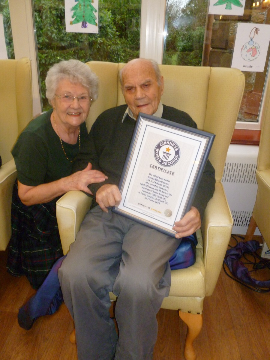 Dan Clement with his friend Heather Dodds and his Guiness certificate. See Centre Press story CPBESTMAN; A centenarian has been officially recognised as the oldest best man at a wedding - at the age of 102. Farmer Dan Clement - who is only SEMI-retired - broke the world record after organising a stag do that involved drinking shots of whisky. He also had wedding guests in stitches with a traditionally funny speech featuring a series of jokes about a ploughman and his cows. Dan agreed to the honour for lifelong friend, Alex 'Sandy' Little, and his bride Sue, who got married in June.