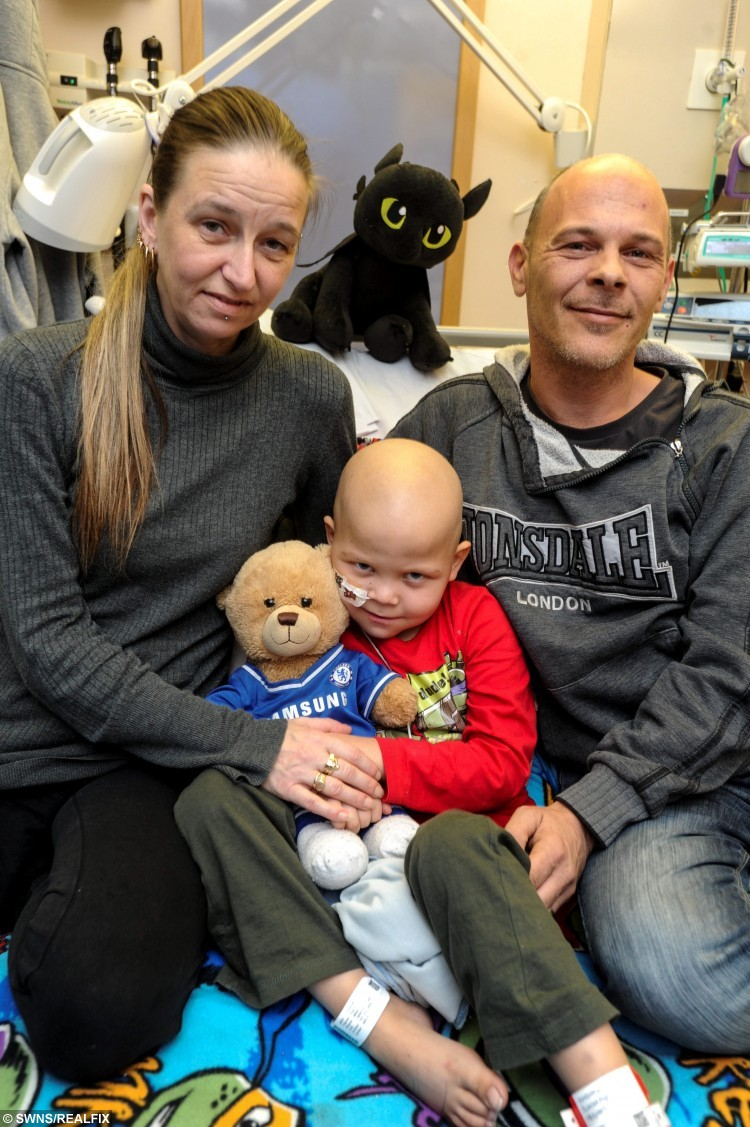 "FILE PICTURE - Tommi Miller in hospital with Parents Kevin and Ruth. See Masons story MNCANCER; An eight-year-old boy who is too sick to eat a piece of chocolate from his advent calendar is hoping his unborn sister may help cure him of his illness. Tommi Miller, who has suffered from leukaemia since he was three-years-old, begs his parents to be a normal boy. But the cancer has spread to his spine, brain, and bone marrow, and he has been so sick that he has not eaten for a month. This year Tommi's health has deteriorate but his parents are hoping that his unborn sister could give him vital stem cells to save his life. His mum, Ruth, 39, said: "" Our hope is to spend Christmas as a family and face the prospect of transplant after the new year. ""Our baby is due on January 8 and we have great hopes she will be a match for a stem cell harvest for Tommi, its the best gift we could ever give him."""