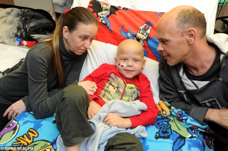 "FILE PICTURE -  Tommi Miller with parents Kevin and Ruth. See Masons story MNCANCER; An eight-year-old boy who is too sick to eat a piece of chocolate from his advent calendar is hoping his unborn sister may help cure him of his illness. Tommi Miller, who has suffered from leukaemia since he was three-years-old, begs his parents to be a normal boy. But the cancer has spread to his spine, brain, and bone marrow, and he has been so sick that he has not eaten for a month. This year Tommi's health has deteriorate but his parents are hoping that his unborn sister could give him vital stem cells to save his life. His mum, Ruth, 39, said: "" Our hope is to spend Christmas as a family and face the prospect of transplant after the new year. ""Our baby is due on January 8 and we have great hopes she will be a match for a stem cell harvest for Tommi, its the best gift we could ever give him."""