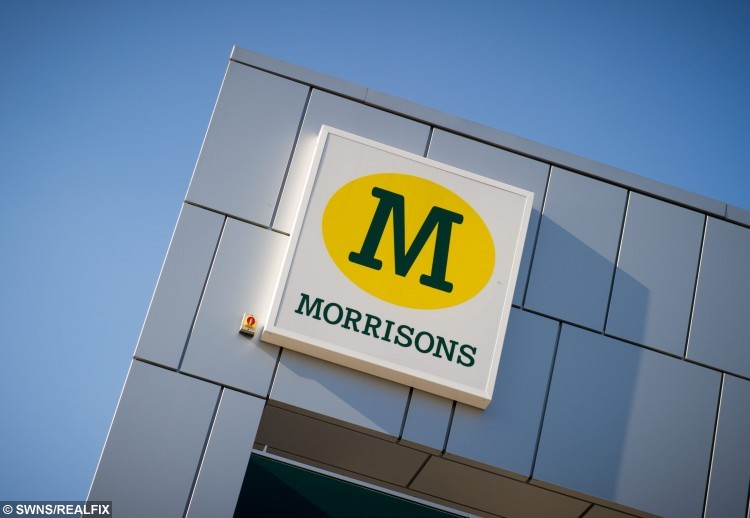 """FILE PICTURE - GV of a Morrisons supermarket sign. See Masons story MNBABY; A young mum has been fined for overstaying her free time limit in a car park because she was breastfeeding her daughter.Anna Scriven, 28, was so preoccupied feeding and changing her then seven-week-old daughter Molly that she forgot about the free two-hour time limit at Riverside Retail Park, Norwich. She returned an hour late and was subsequently handed a Ã50 fine by firm ParkingEye two weeks later. The mum-of-two girls said: """"It was very much a fraught mum trying to get out of the house for the day with a new born, because I was getting a bit of cabin fever. """"It does take an hour to breast feed a seven-week-old sometimes. These things aren't as simple as sticking a bottle in their mouth and letting them drink for 15 minutes, it's not quite the same thing when you're breast feeding."""