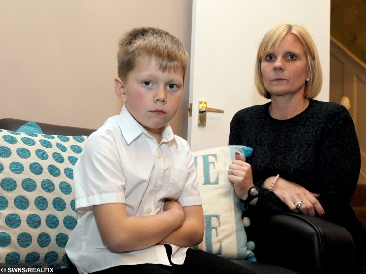 Faye May with her son, Ozzie, five, who was not allowed to see the Inside Out film at School because he didn't have the required level of attendance. A boy who missed school after being injured in a car accident was banned from an end of term event – due to poor attendance.  See MASONS story MNRUN.  Ozzie May, five, of Sutton at Hone Primary School, Dartford, Kent, was knocked down by a car on September 6 and spent time in hospital before being sent home to recover.  That meant missing nine days of school, which saw his attendance drop below the 96% threshold required for him to enjoy an after-school film screening with friends on Tuesday.