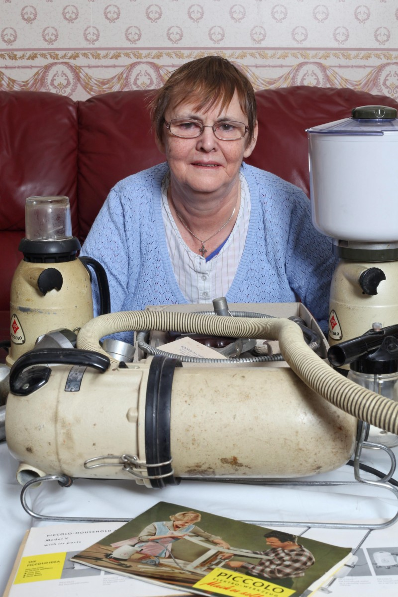 Mary Waite from Halesowen, Birmingham with her Piccolo machine.See News Team story NTIPICCOLO; A gran is the proud owner of the world's oldest and most versatile household appliance - which makes dinner, hoovers, paints and even grinds coffee beans. Mary Waite, 63, and her husband Ivor, 65, have been using their Piccolo multi-purpose appliance since it was given to them as a wedding present in 1976. Remarkably, the old plastic and metal gadget, which does four household chores in one still works today and has never broken down.