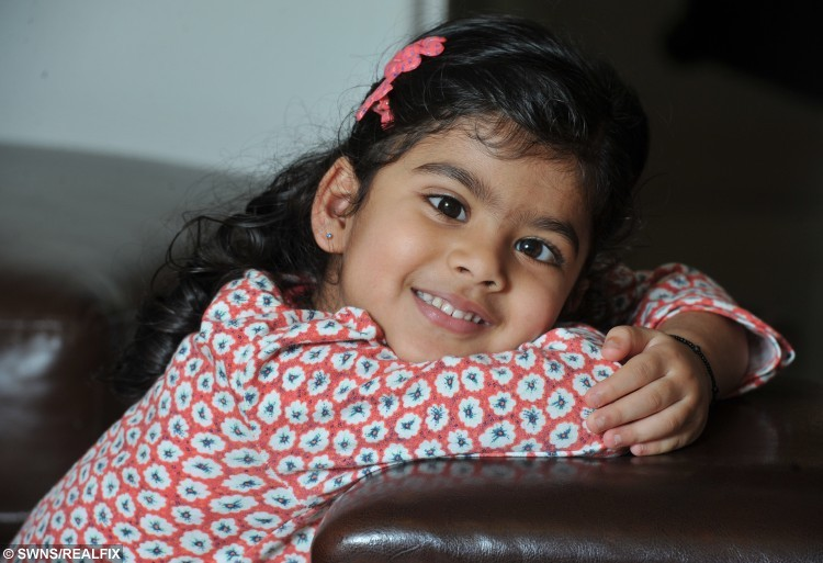 "Three year old Khaya Panchal, from Preston, Lancashire, who was diagnosed with retinoblastoma and now has an artificial eye. See Ross Parry copy RPYEYE : A toddler has been fitted with a ""special eye"" after having hers removed to save her life. Little Khaya Panchal, three, was diagnosed with rare cancer retinoblastoma after her parents spotted a glint shining from her right eyeball.  They quickly took a photograph, and the flash revealed a shining halo, which further tests found to be a potentially fatal tumour. Dad Ritesh, 33, said: ""The sun was on Khaya's face as she was falling asleep and I saw this strange glint in her eye.  ""One of her eyes was normal but the other had a glass marble effect and it looked like a big ring in her eye."