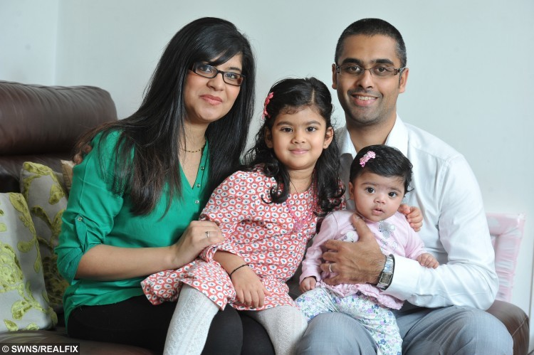 "Three year old Khaya Panchal, from Preston, Lancashire, who was diagnosed with retinoblastoma and now has an artificial eye. Pictured with her mum Nisha and dad Ritesh, and her baby sister Maya. See Ross Parry copy RPYEYE : A toddler has been fitted with a ""special eye"" after having hers removed to save her life. Little Khaya Panchal, three, was diagnosed with rare cancer retinoblastoma after her parents spotted a glint shining from her right eyeball.  They quickly took a photograph, and the flash revealed a shining halo, which further tests found to be a potentially fatal tumour. Dad Ritesh, 33, said: ""The sun was on Khaya's face as she was falling asleep and I saw this strange glint in her eye.  ""One of her eyes was normal but the other had a glass marble effect and it looked like a big ring in her eye."