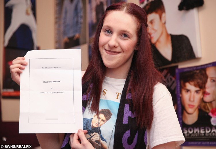 """Gabrielle Newton-Bieber, 22 of Worksop, Nottinghamshire, who is a Bieber fanatic and changed her name by deed poll. See Ross Parry copy RPYBIEBER : The Justin Bieber super-fan from Worksop has legally taken her idol's surname hopes her """"Belieber"""" dedication will convince the star to meet-up when he performs in Sheffield. Gabrielle Newton-Bieber, aged 22, who sleeps by a life-sized cardboard cut-out of the star, said she changed her name on her 18th birthday - two years after falling for the heart-throb. The 'number-one fan' has five Bieber tattoos and owns every record, DVD, perfume, nail polish and make-up the star has ever put his name to. She also has a wardrobe full of Justin Bieber clothes, as well as a bounty of posters and other merchandise."""