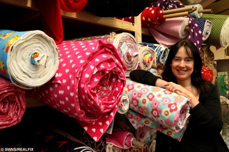 Kate Dawson, founder of The All-in-One Company which is based in Ashington in Northumberland which is providing off cuts of onsies for orphaned hedgehogs. Thirty blankets, created out of leftover onesie material, have been made for the Cleveland Hedgehog Preservation Society (CHPS) in tyneside by staff at The All-in-One Company which makes onesies. December 3 2015. See Ross Parry copty RPYONE : These rescued hedgehogs are kept alive and warm with blankets - made from ONESIES. Dozens of the prickly creatures found struggling in the wild are being nursed to health in the freeze-busting fleeces. A mini blanket made out of a onesie will help keep hedgehogs including orphans Autumn and Titch warm during the winter. Thirty blankets, created out of leftover onesie material, have been made for the Cleveland Hedgehog Preservation Society (CHPS) by staff at The All-in-One Company. It has dozens of bags of remnant material and asked charities throughout the North East how it could be put to good use.