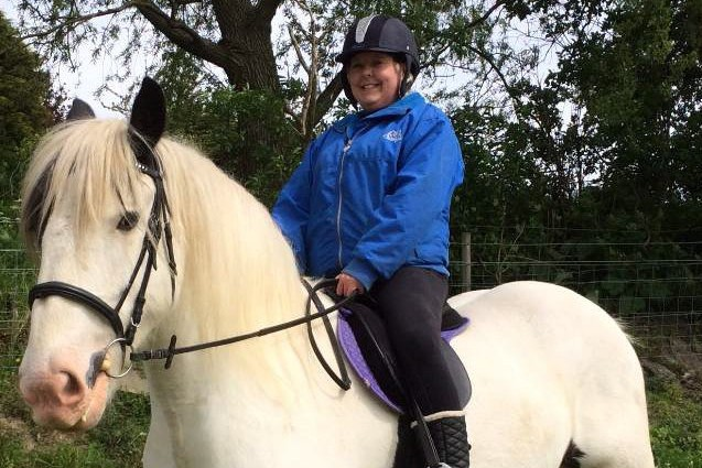 Mum left brain-damaged after thugs pelted her horse with stones