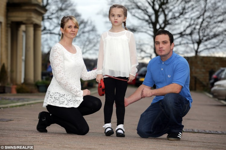 """Isla Kerr, 7, who wrote a letter to Santa Claus asking him to find her lost dog Dolly with her parents Vanessa Meskimmon and Darren Kerr. See Ross Parry Copy RPYLETTER: A heartbroken little girl has written a touching letter to Santa asking for him to bring her beloved pet dog home after she was stolen by cruel thieves. Devastated Isla Kerr, seven, put pen to paper after telling mum Vanessa Meskimmon, 'Santa can do anything', pleading for Boston terrier Dolly to be brought back safely. The three-year-old dog is blind and requires daily medication, and the family say she will be terrified not knowing where she is. Isla's handwritten note reads: """"Dear Santa, All I want for Christmas is my dog to come back."""""""