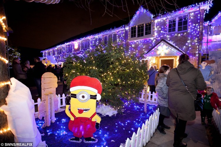 Andy McNab from Becontree, East London, turned on his Minions themed Christmas lights today with the help from Eastenders actor, Jamie Borthwick. The lights which stretch across 5 different houses drew large crowds from the local area.   See SWNS story SWMINION - A Dagenham granddad has covered six houses in thousands of lights and pictures to make an awesome festive display of Minions - despite NEVER seeing the film.
