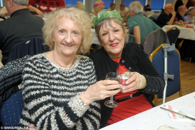 "Jean Sowden (left) and Karen Knight at the Camborne Rugby Club Christmas dinner which was paid for by kind hearted solicitor Peter Campbell. See SWNS story SWLUNCH; A kind-hearted pensioner treated 50 strangers to a slap-up Christmas dinner at his local rugby club to ensure they were not alone over the festive period – and footed the £2K BILL. Retired solicitor Peter Campbell, 87, paid for the festive feast for people in his local community who would otherwise be spending the festive period alone. Generous Peter booked out his local rugby club in Camborne, Cornwall, and laid on a platter of turkey and wine, and he footed the £2,000 bill. Peter was ceaselessly thanked for his efforts, and now he intends to make the meal an annual tradition, and he said he will continue to do the event ""as long as I've got air in my lungs""."