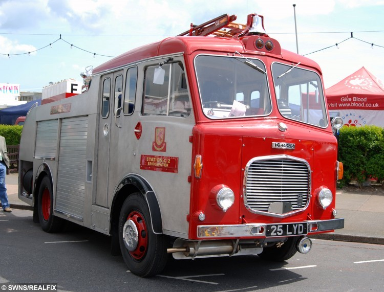 Dennis fire engine from the 1960's. RE,The Gunn family. See SWNS story SWFIRE; A young cadet recreated a picture taken of his father and grandfather to complete a sixty year family tradition of joining the fire brigade. Owen Gunn, 16, joined the London Fire Brigade as cadet, following in the footsteps of the two generations that came before him. Owen's grandfather Colin Gunn became a firefighter in 1966 and posed for a photograph outside Southwark Training Centre on the day of his pass out ceremony. ColinÃs son, Crew Manager Nick Gunn, joined in 1988 and had his photograph taken in exactly the same place and is currently based at Romford Fire Station. Colin retired in 1991, however, for a few years both father and son served in the Brigade at the same time. Now Owen has had his image taken in exactly the same as he trains with the Fire Cadets to one day become a firefighter himself.