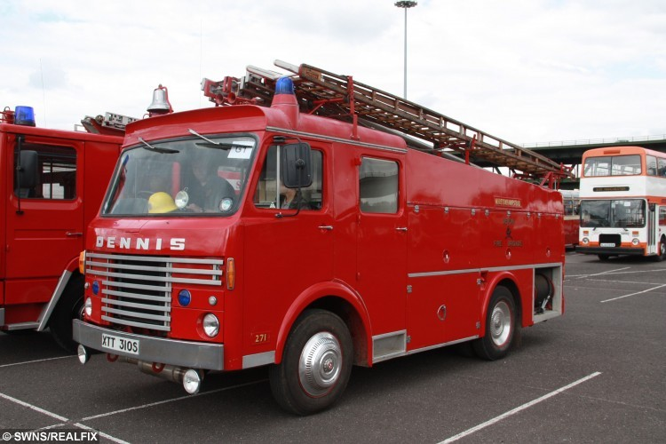 Dennis fire engine from the 1980's. RE,The Gunn family. See SWNS story SWFIRE; A young cadet recreated a picture taken of his father and grandfather to complete a sixty year family tradition of joining the fire brigade. Owen Gunn, 16, joined the London Fire Brigade as cadet, following in the footsteps of the two generations that came before him. Owen's grandfather Colin Gunn became a firefighter in 1966 and posed for a photograph outside Southwark Training Centre on the day of his pass out ceremony. ColinÃs son, Crew Manager Nick Gunn, joined in 1988 and had his photograph taken in exactly the same place and is currently based at Romford Fire Station. Colin retired in 1991, however, for a few years both father and son served in the Brigade at the same time. Now Owen has had his image taken in exactly the same as he trains with the Fire Cadets to one day become a firefighter himself.