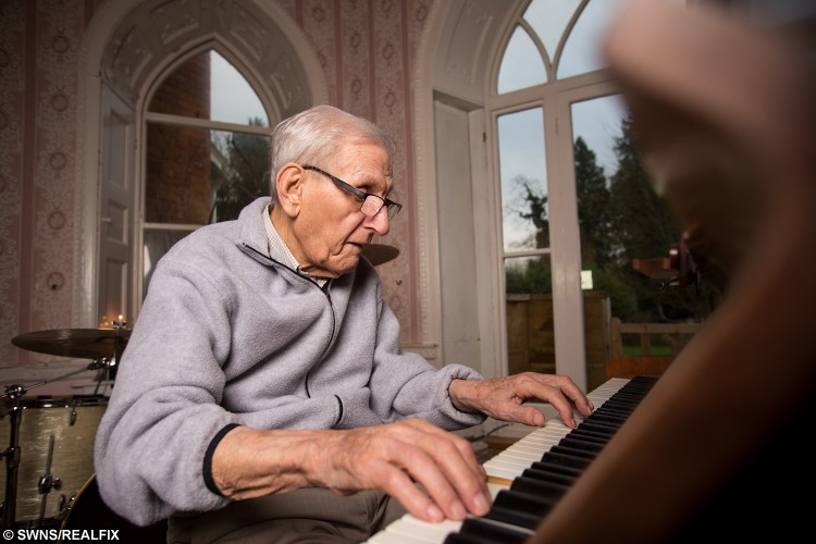 Edward Hardy, 93, pictured at Mellifont Abbey care home in Wookey, where Activities Coordinator Sam Kinsella put an advert on Gumtree to find him band members to play with. See SWNS story SWJAM; Musicians have come forward to jam with a 95-year-old pianist after a nationwide appeal was made on Gumtree to find him some new bandmates. The festive wish was granted for ex jazz player, Edward Hardy, when more than 80 musicians from across the UK replied to the heart-warming advert. Amazingly, despite now suffering from dementia, the talented war veteran has still retained his piano playing abilities. The pensioner wanted to start a new band because he felt so lonely after being separated from his wife for 75 years, Betty, 91, due to moving into a care home in Wookey, Somerset.