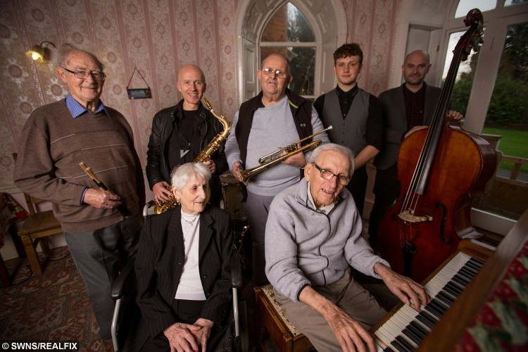L to R: Ron Foster, Jazz Jackson, David Payne, Sam Kinsella, Greg Cordez, Betty Hardy and Edward Hardy, 93, pictured at Mellifont Abbey care home in Wookey, where Activities Coordinator Sam Kinsella put an advert on Gumtree to find him band members to play with. See SWNS story SWJAM; Musicians have come forward to jam with a 95-year-old pianist after a nationwide appeal was made on Gumtree to find him some new bandmates. The festive wish was granted for ex jazz player, Edward Hardy, when more than 80 musicians from across the UK replied to the heart-warming advert. Amazingly, despite now suffering from dementia, the talented war veteran has still retained his piano playing abilities. The pensioner wanted to start a new band because he felt so lonely after being separated from his wife for 75 years, Betty, 91, due to moving into a care home in Wookey, Somerset.