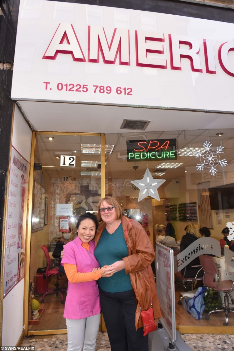 USA Nail technichian Holly Pope with Client Deborah Thompson, Bristol.  See SWNS story SWTOE; A woman who suffered crippling foot pain for 15 years has had her life transformed - after a beautician yanked her TOE during a pedicure. Debbie Thompson, 54, suffered a dropped metatarsal in 2001 which left her with a 1cm lump of BONE protruding from the ball of her left foot.  *** Local Caption ***  (C)2015 paul@paulgillisphoto.com     +44 07791 066 852 USA Nail technichian Holly Pope with Client Deborah Thompson, Bristol.  See SWNS story SWTOE; A woman who suffered crippling foot pain for 15 years has had her life transformed - after a beautician yanked her TOE during a pedicure. Debbie Thompson, 54, suffered a dropped metatarsal in 2001 which left her with a 1cm lump of BONE protruding from the ball of her left foot.